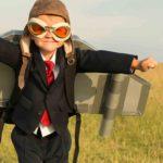 Child wearing pilot hat